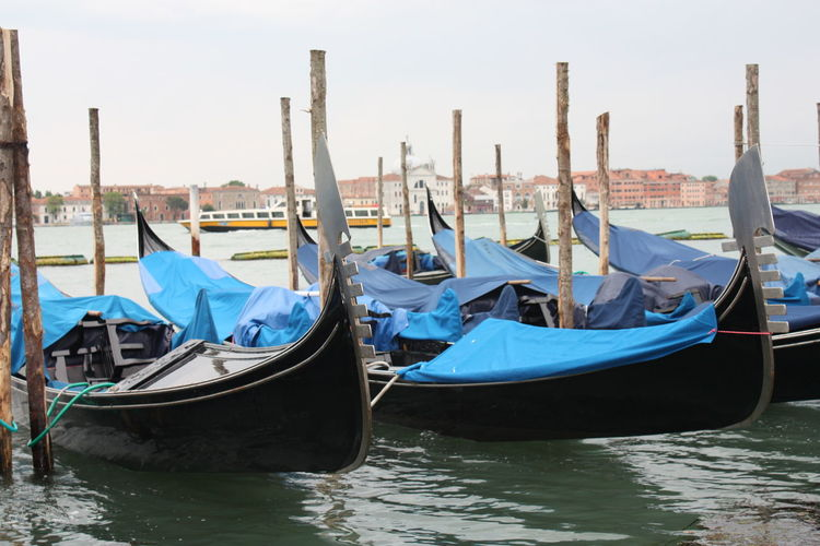 Gondolas moored in canal