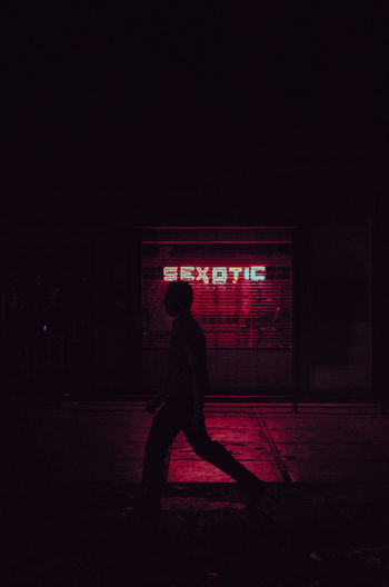 Sexotic Adult Adults Only Full Length Illuminated Men neon life Night One Man Only One Person Outdoors People Real People Red Side View Silhouette Standing Streetphotography