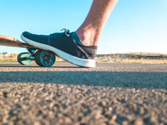 Longboard Longboard Low Section Body Part Human Body Part Human Leg Shoe Sunlight Day Lifestyles Surface Level Skateboard
