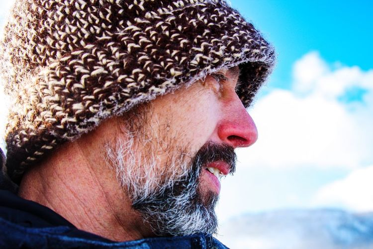 Close-up of mature man wearing knit hat