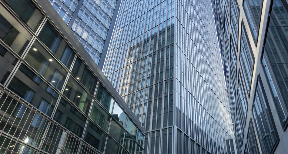 Abstract modern office buildings Building Exterior Architecture Built Structure Building City Modern Glass - Material Low Angle View Office Building Exterior Office Reflection No People Outdoors Day Window Skyscraper Business Nature Full Frame Finance Financial District