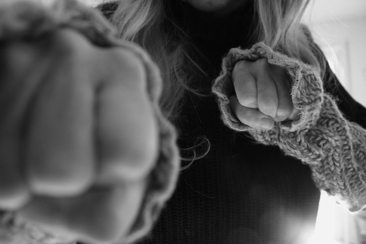 Close-up of woman woman with clenched fist