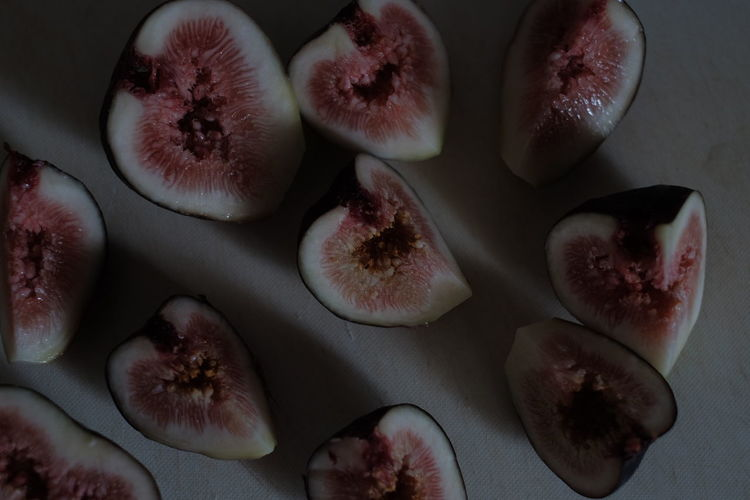 Directly above shot of sliced figs on table
