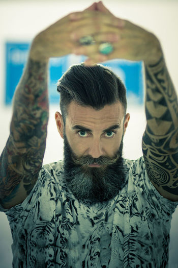 Beard Beard Life Beards Beauty And The Beard Blackwork Tattoo Confidence  Contemplation Front View Happiness Head And Shoulders Headshot Human Face Lifestyles Long Beard Looking At Camera Man Beauty Footer Men Meanswear Perspective Portrait Real People Serious Tattoo Tattoos Style Young Adult Young Men