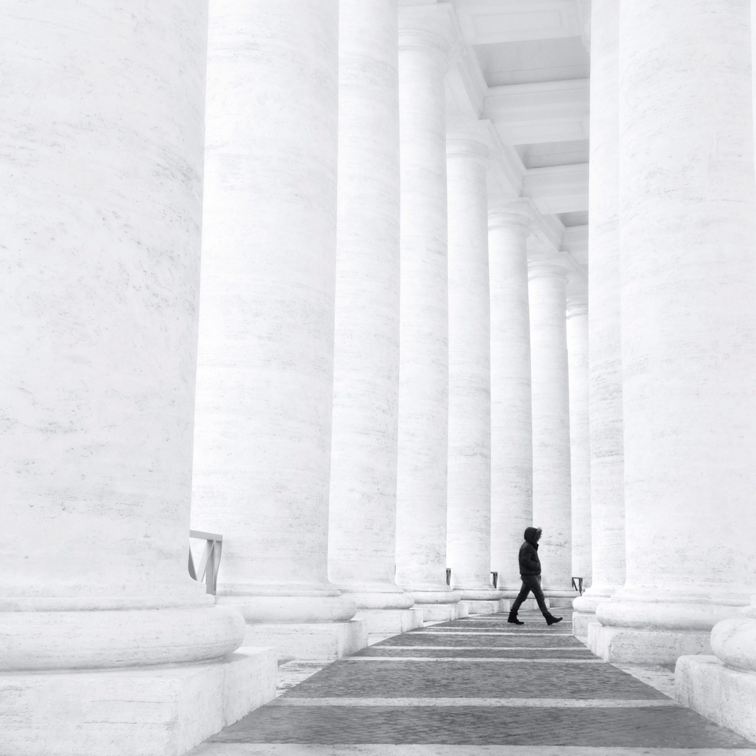 architecture, built structure, building exterior, walking, the way forward, men, full length, steps, building, rear view, lifestyles, sunlight, shadow, corridor, person, wall - building feature, day, architectural column