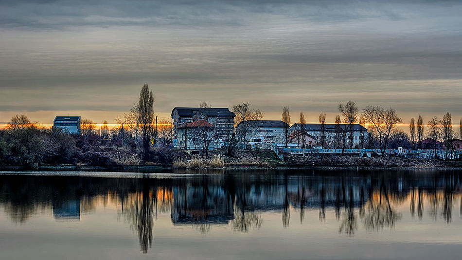Sunset Architecture Building Exterior Built Structure Cloud Cloud - Sky Cloudy Lake Moored Nature Outdoors Reflection River Sky Standing Water Sunset Tranquility Transportation Tree Water Waterfront
