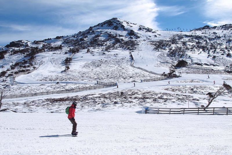 Person Skiing On Snow Against Mountain