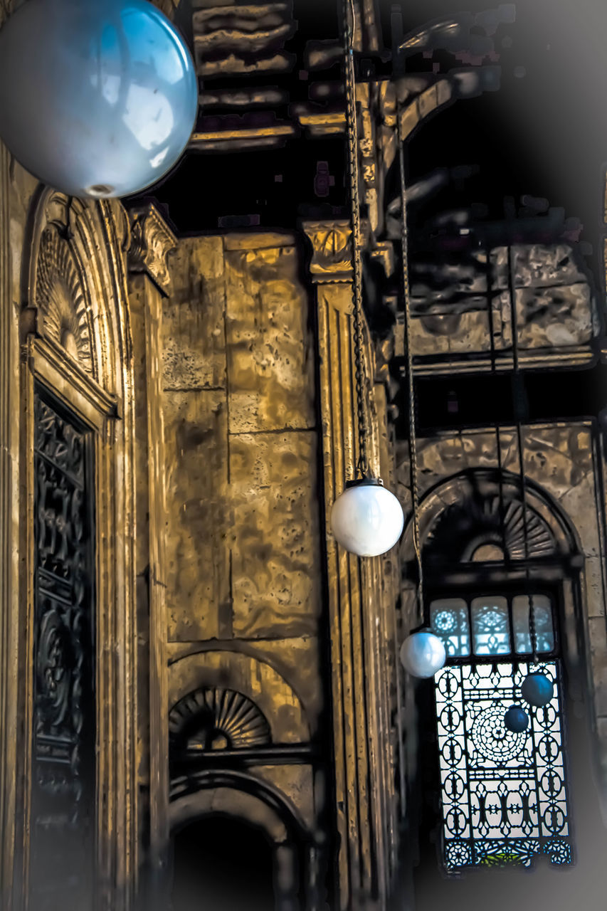 architecture, built structure, lighting equipment, no people, indoors, low angle view, building, hanging, art and craft, creativity, decoration, ornate, design, human representation, representation, sphere, ceiling, religion, pattern, illuminated, glass, floral pattern