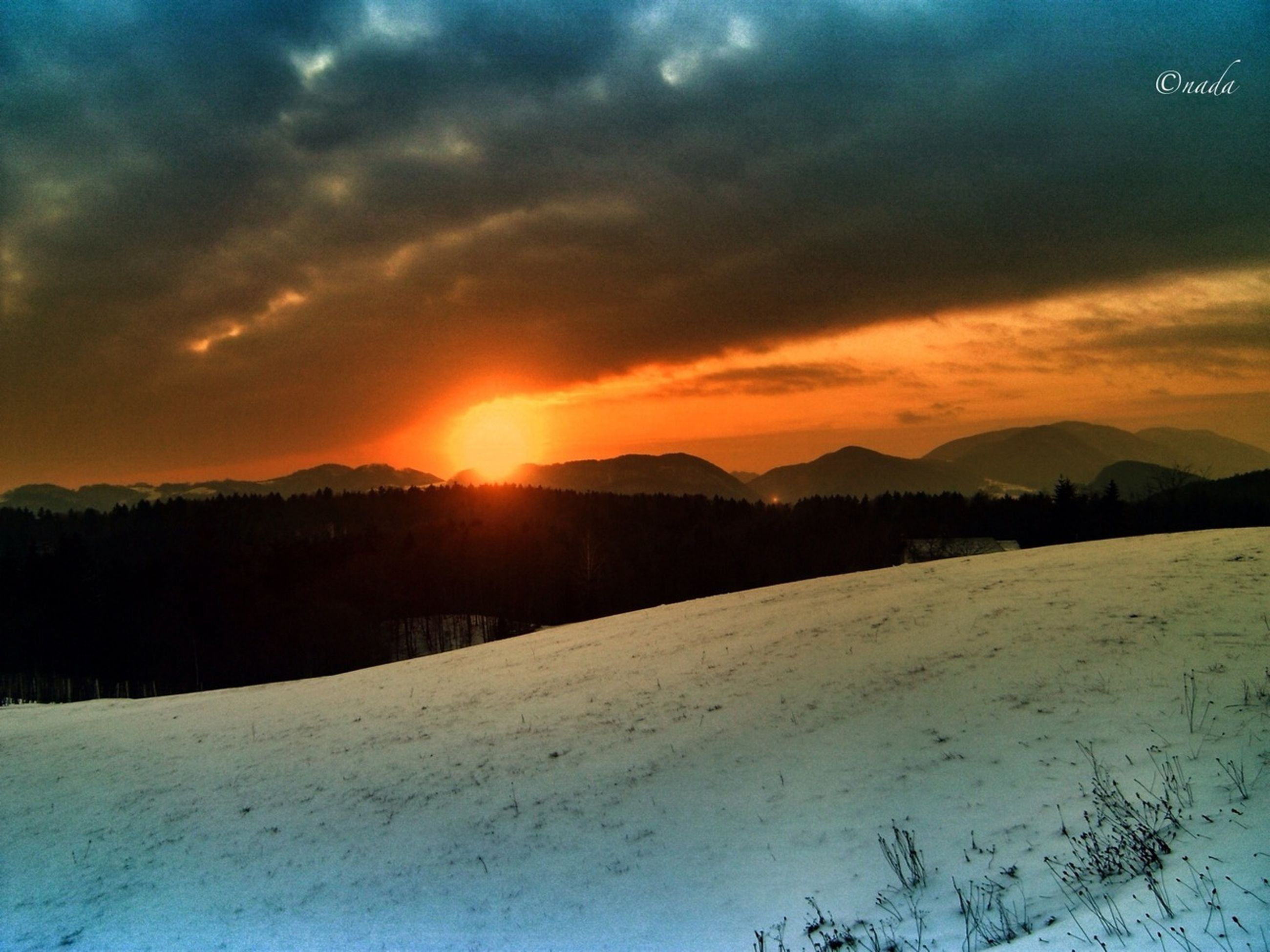 snow, winter, cold temperature, sunset, tranquil scene, scenics, season, tranquility, beauty in nature, landscape, weather, sky, sun, covering, orange color, nature, cloud - sky, mountain, idyllic, frozen