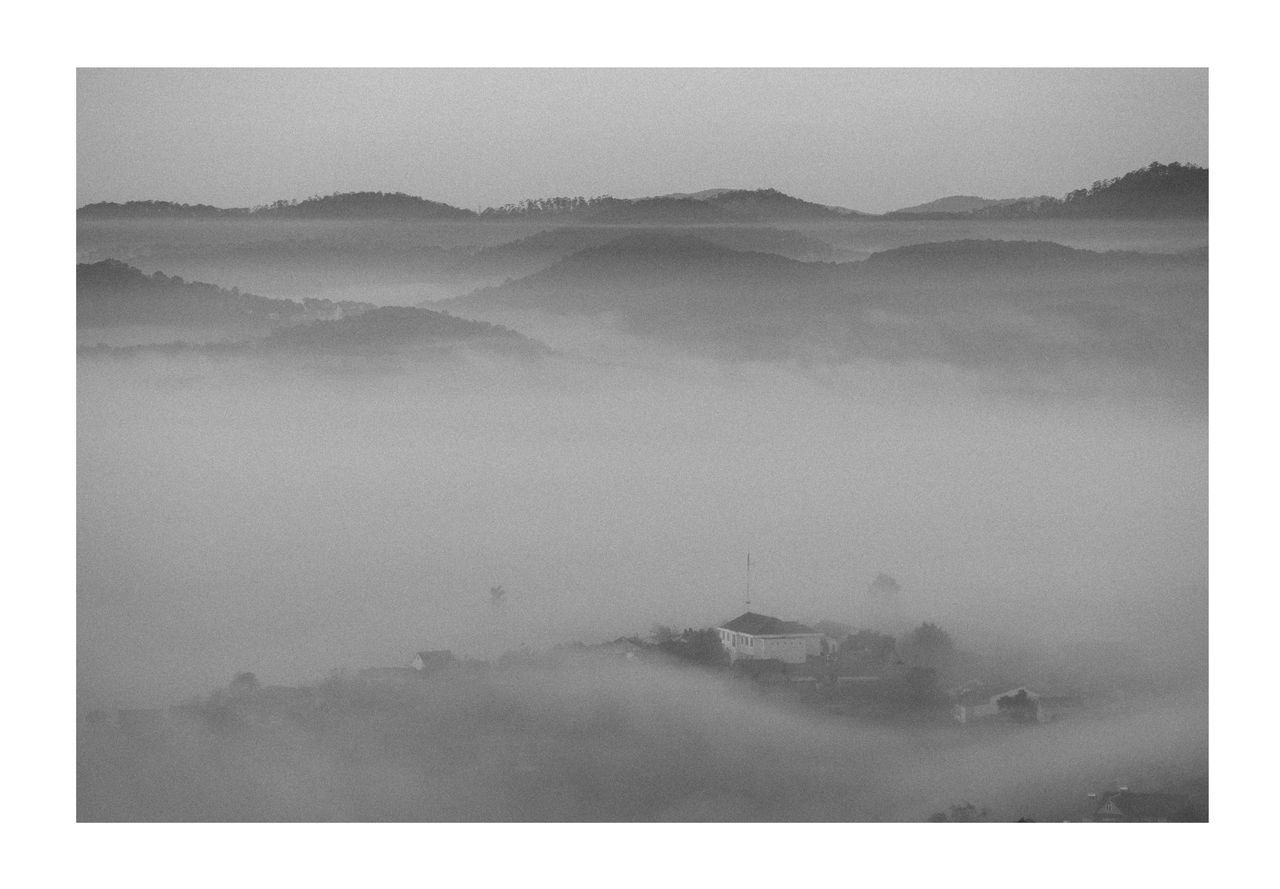 HIGH ANGLE VIEW OF FOG OVER LANDSCAPE