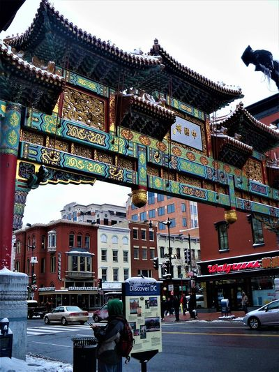Chinatown, Washington, D.C. Architecture Building Exterior Built Structure City Real People Building Group Of People Day People Place Of Worship Incidental People Street Sky Outdoors Washington, D. C. Chinatown Chinese Chinese Culture USA Travel Nations Capital Travel Destinations Snow Ice Icecicles