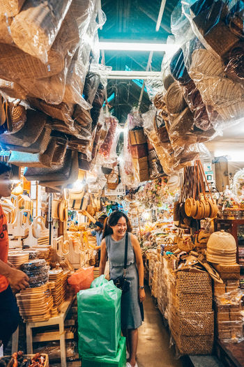 Woman standing at market stall