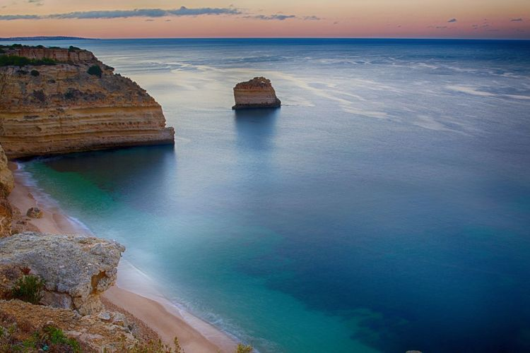 Scenic View Of Praia Da Marinha Beach During Sunset