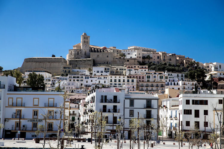 Apartment Architecture Blue Building Building Exterior Built Structure City Clear Sky Community Copy Space Dalt Vila Day House Ibiza City Low Angle View Nature No People Outdoors Residential District Sky Sunlight TOWNSCAPE Tree Town Historic Tall