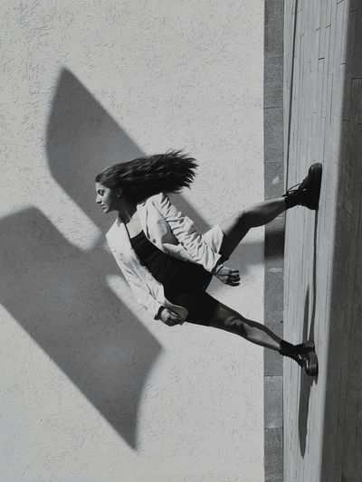 Side view of woman shadow on wall