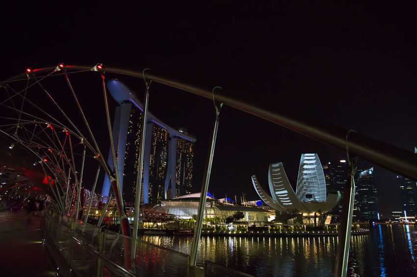 Harbour View Marina Bay Sands Night Lights Amusement Park Ride Architecture Arts Culture And Entertainment Bridge - Man Made Structure Building Exterior Built Structure City Clear Sky Dark Fairground Ferris Wheel Glowing Hotel Illuminated Luxury Nature Night No People Outdoors Sky Travel Destinations Water