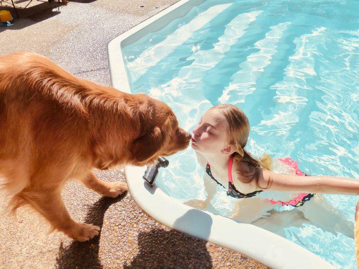 Girl kissing dog