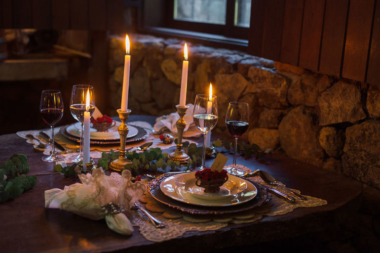 Table setting with candles and wine glasses