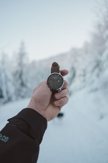 Human Hand Hand Human Body Part Time Cold Temperature Winter Snow Holding Watch Nature Day Clock One Person Focus On Foreground Real People Sky Instrument Of Time Personal Perspective Human Finger Finger Outdoors Wristwatch