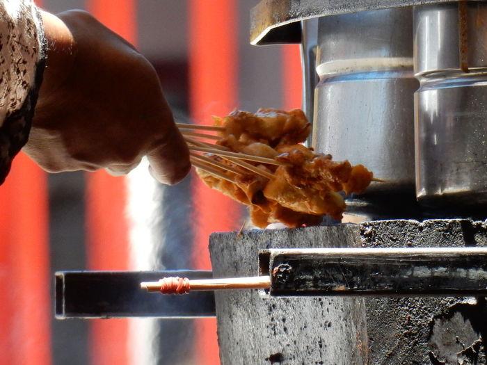 Close-up of preparing street food