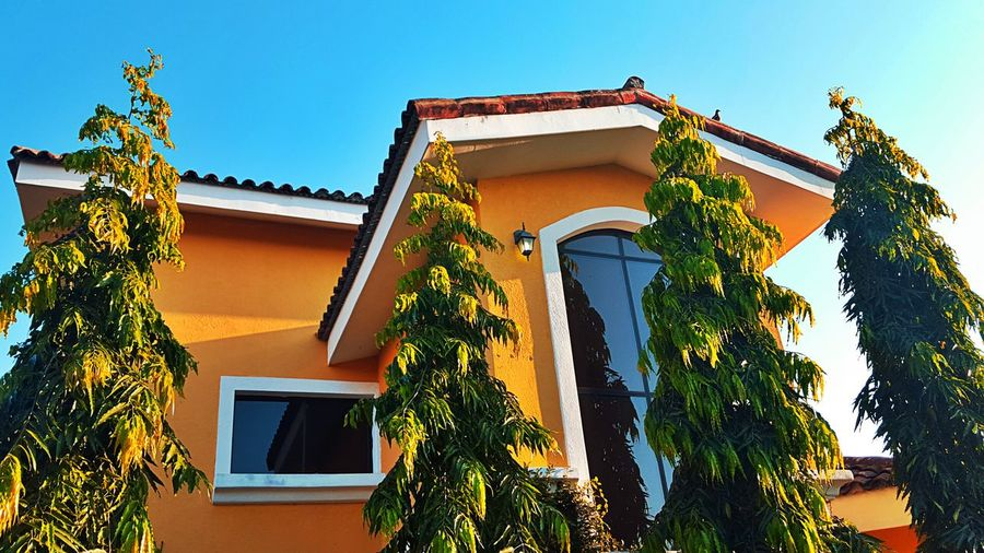 Low angle view of house against clear sky