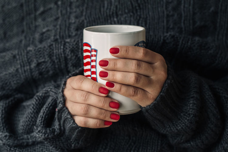 Midsection Of Woman Having Coffee In Cup