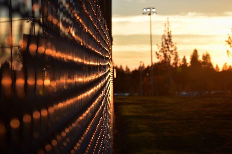Close-Up Of Metallic Structure Against Orange Sky