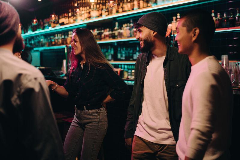 Smiling friends enjoying at bar