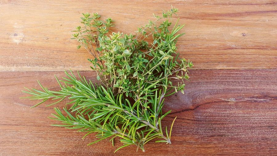 High Angle View Of Herbs On Table