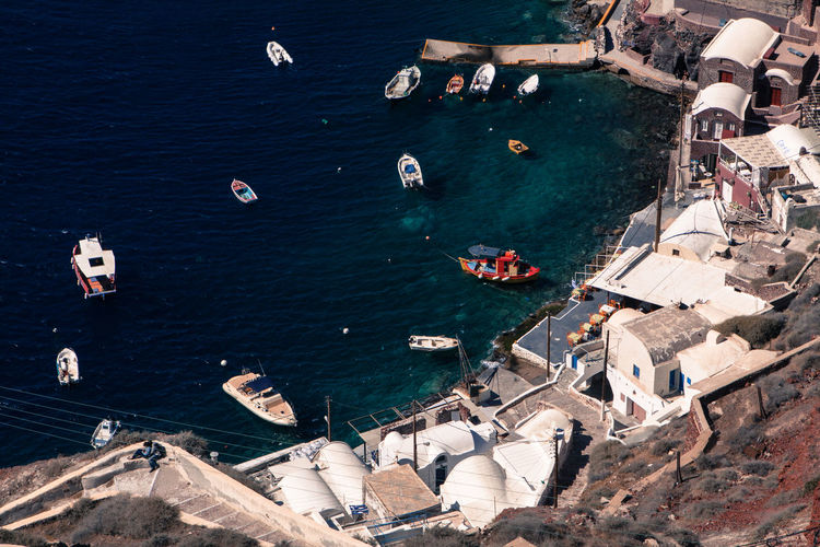 Oia village in Santorini island, Greece. Boats Elevated View Grecia Greece GREECE ♥♥ Greek Greek Islands Harbour Harbour View Holiday Nautical Vessel Oia Oia Santorini Sea Sea And Sky Seaside Tourism Travel Travel Destinations Village Village View