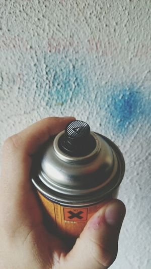 Cropped Image Of Man Holding Aerosol Can