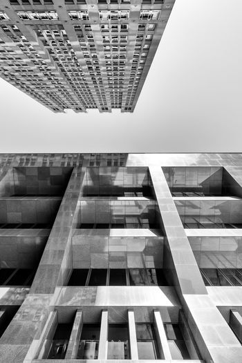 Architectural Feature Architecture Backgrounds Blackandwhite Building Building Exterior Built Structure City City Life Day Directly Below Geometric Shape Low Angle View Modern No People Office Building Outdoors Repetition Sky Skyscraper Tall Tall - High The Architect - 2016 EyeEm Awards
