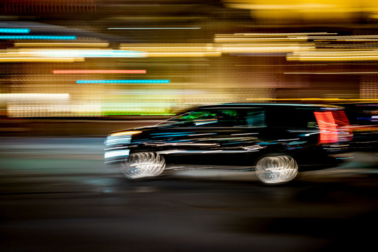 Blurred motion of traffic on road at night