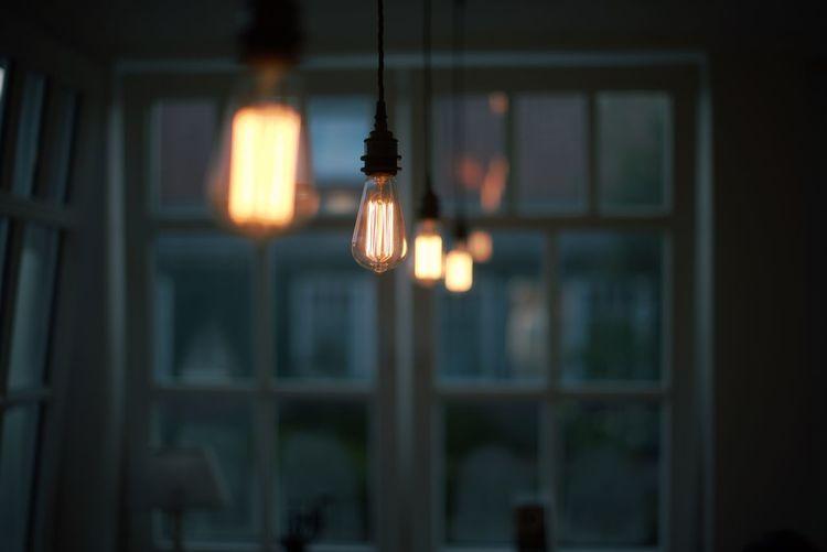Illuminated Light Hanging At Home