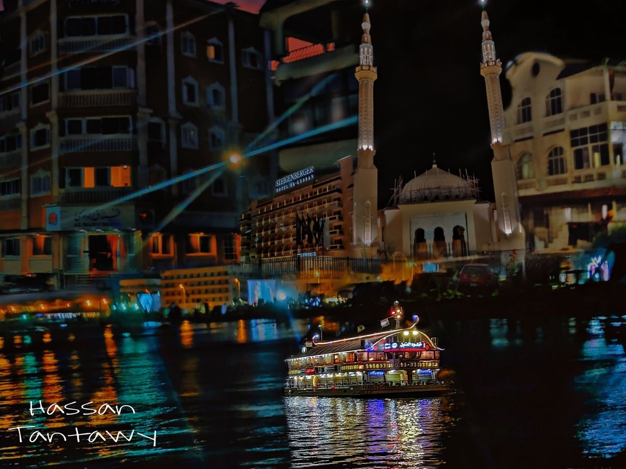 building exterior, water, architecture, built structure, night, city, illuminated, transportation, nautical vessel, mode of transportation, waterfront, building, reflection, travel, river, nature, outdoors, no people, travel destinations