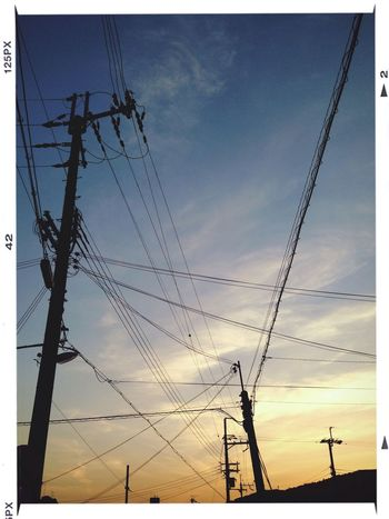 Cloud And Sky Power Lines Sunset