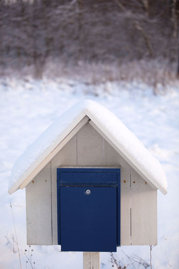 Winter Cold Temperature Snow White Color No People Focus On Foreground Day Nature Built Structure Wood - Material Outdoors Architecture Close-up Birdhouse Building Exterior Blue Mailbox Hut Deep Snow Holiday Moments