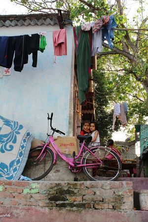 Bicycle Clothesline Outdoors Hanging Building Exterior Architecture Multi Colored Kids At Play Kids Are Awesome Kids Of EyeEm Kidsportrait Kid Photography Portrait Delhi, Photography Delhiphotographers DelhiNCR YamunaGhat Art Is Everywhere EyeEm Diversity EyeEmNewHere Break The Mold Cut And Paste