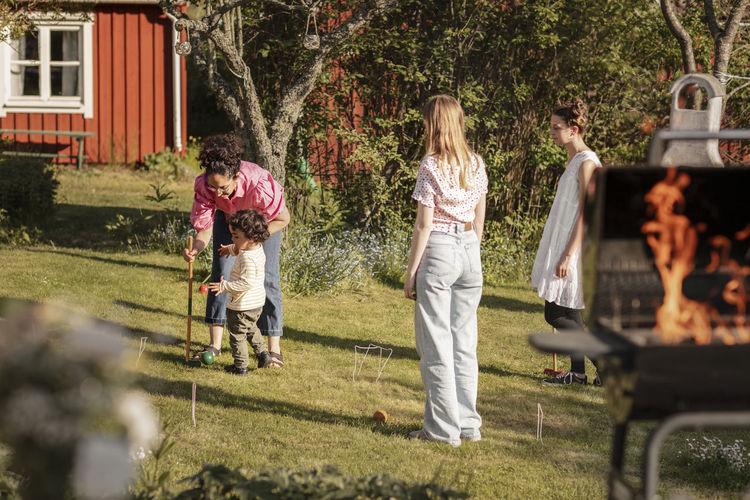 People standing in yard