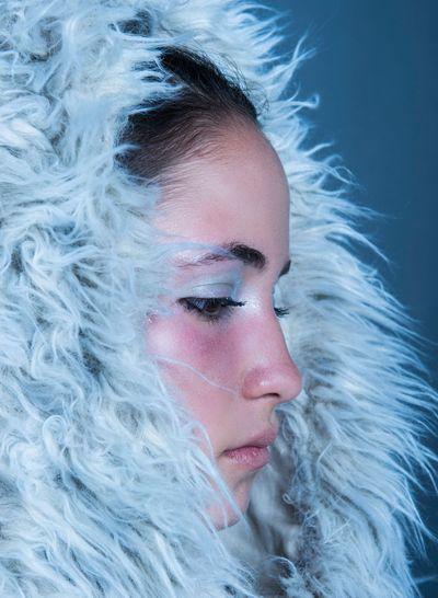 Close-Up Of Woman Wearing Fur Hood