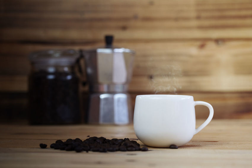 white cup of coffee with wood background Moka Pot Close-up Coffee Coffee - Drink Coffee Cup Container Crockery Cup Drink Focus On Foreground Food Food And Drink Freshness Indoors  Mug No People Refreshment Roasted Coffee Bean Still Life Sweet Food Table Wood - Material