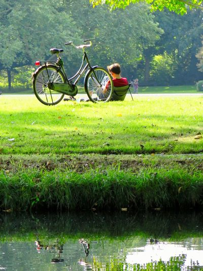 Bicycle Water Plant Land Vehicle Transportation Mode Of Transportation Green Color Nature People Leisure Activity Lifestyles Outdoors Day EyeEmNewHere