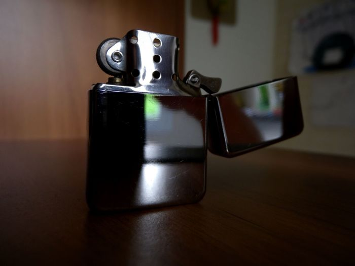 Close-Up Of Cigarette Lighter On Table