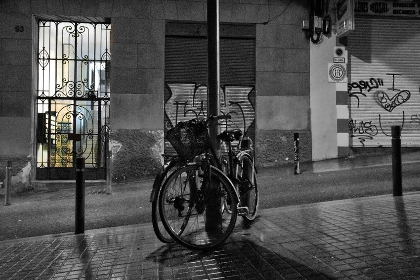 A pair of bicycles in the middle of the street Barcelona Rain Rainy Days Bicycle Building Exterior City Mode Of Transportation No People Old Bulding Outdoors Street Transportation Wet