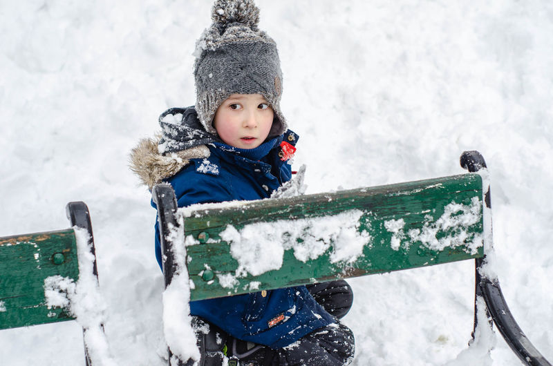 Boy with sled on snow