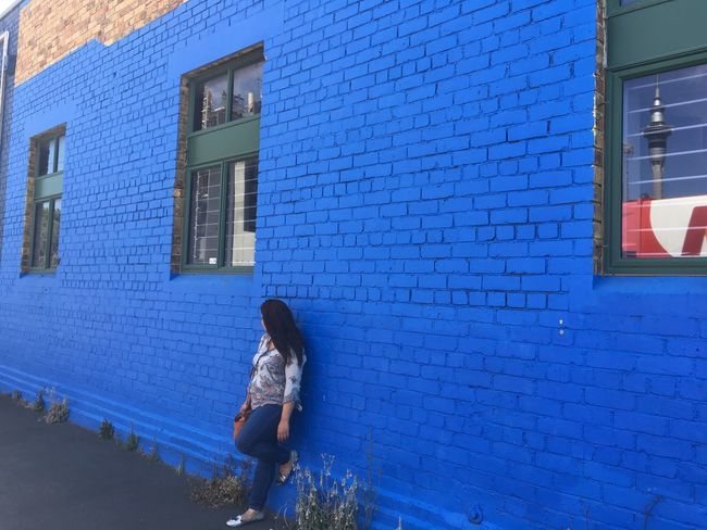 Brick Wall Travel Wall Architecture Blue Wall Building Exterior Built Structure Day Lifestyles New Zealand One Love One Person Outdoors People Real People Standing Travel Destinations Window Windows Women Press For Progress Colour Your Horizn