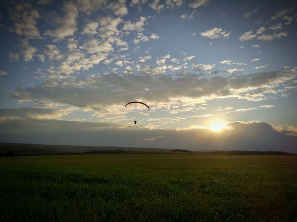 HuaweiP9 Sport Landscape Sunset Sky Nature Sunlight Flying Paragliding Extreme Sports Grass Cloud - Sky People One Person One Man Only Motorparagliding Adult Lost In The Landscape Adventure Field Sun Outdoors Silhouette Lifestyles Go Higher