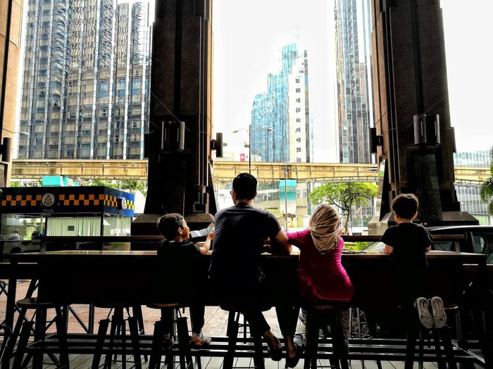 When A Daddy Spend A Time with his Childrens .......... ♥ Rear View Day People Real People Togetherness Sitting Built Structure Architecture Child Sky City Time Square Kuala Lumpur Break Time Enjoy