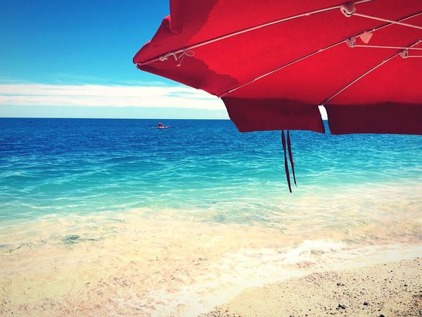 Red umbrella and blue beach ,Vieste ,Italy Sea Water Horizon Over Water Red Sky Beach Scenics Nature Beauty In Nature Outdoors Day No People