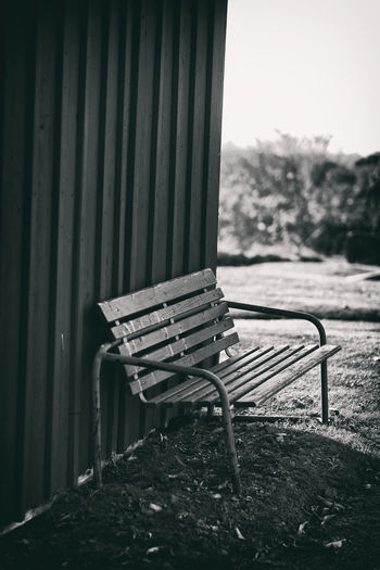 a Bench next to the old leaning shed Cemetery EyeEm Best Shots Fujifilm X-H1 In The Shadows Kungshamn October Sweden Taking Photos Architecture Bank Bench Blackandwhite Day Eyeem Sweden Fujilove Graveyard Höst Kyrkogård Leaning Wall No People Old Outdoors Park Bench Svartvitt Sverige